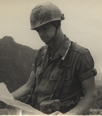 1967 Vietnam photo of then Captain John Ripley studying a map with his trademark smile.