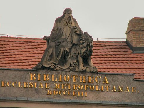"Statue of Saint Jerome on top of the ""Bibliotheca"" building in Esztergom, Hungary."