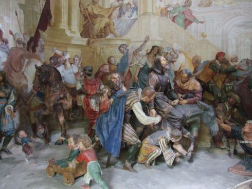 Crowds joyfully receive Saint Francis, as depicted at the Sacro Monte di Orta in Orta San Giulio, Piedmont.