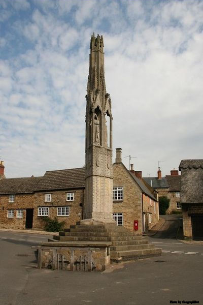Relic from times of faith ― the Geddington Cross, one of twelve, was erected by Edward I to mark the overnight resting places of the funeral cortege of his deceased queen, Eleanor of Castile (d. 1290) in its journey from Lincoln to Westminster Abbey.