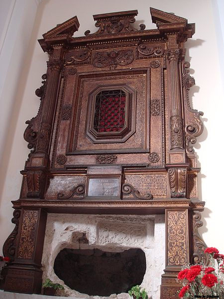 The former grave of Saint Lucy, now empty, but embellished by reliefs dating from the Norman period and by a rich baroque wood frame.
