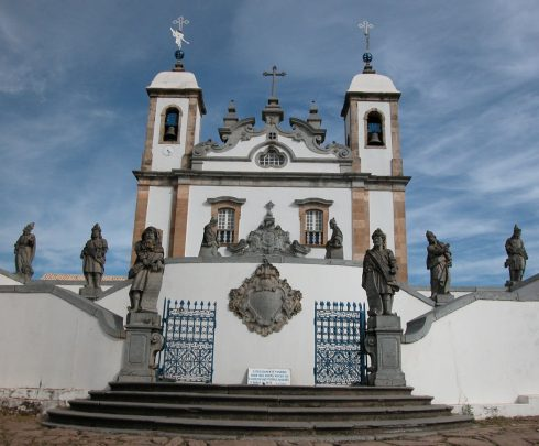 twelve Prophets sculpted by Aleijadinho in front of the church of the sanctuary of Bom Jesus of Matosinhos at Congonhas, Minas Gerais, Brazil ; Isaiah is the first statue on the left on the pillar at the beginning of the steps.