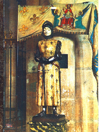Statue of St. Joan of Arc with her banner in the Notre-Dame Reims Cathedral, France