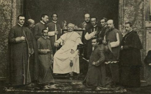 Pope Pius IX surrounded by clerics.