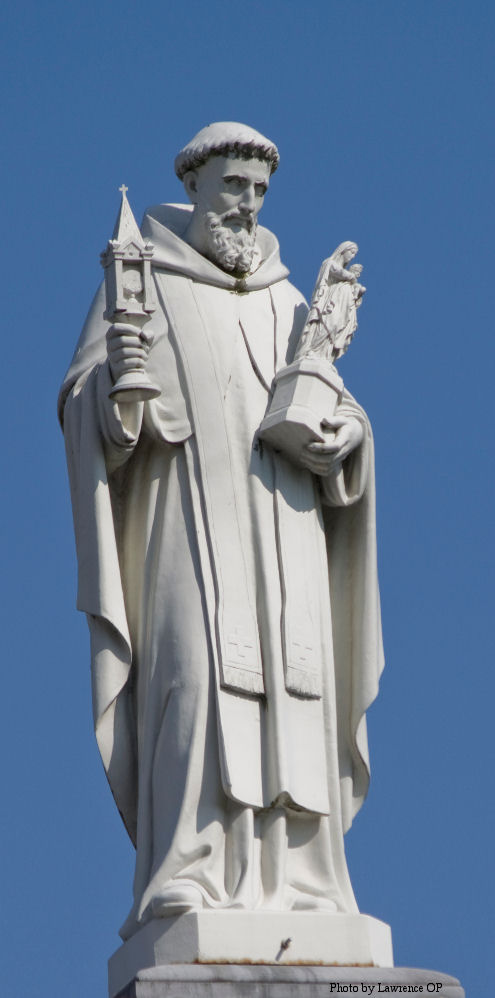 Statue of St Hyacinth overlooking Rosary Square in Lourdes.