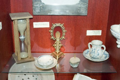 "The hourglass, spoon, and various dishes that were used by St. Teresa. St. Teresa was especially fond of the gospel story of the Samaritan woman at the well seeking the water of life and she would say to Him over and over again, ""Lord, give me that water!"" To her, water always seemed something delightful and marvelous, something at once so natural and so inexplicable, so clearly an evidence of the power and goodness of God, that she was constantly admiring it and trying to think of ways to describe its properties. From her childhood till her death, she never lost this wonder and delight at the sight and feeling of water."