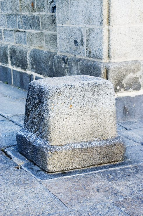 This is the stone that St. Teresa sat on, waiting for King Philip II. This stone, generally goes unnoticed, is on the front left corner of El Escorial.
