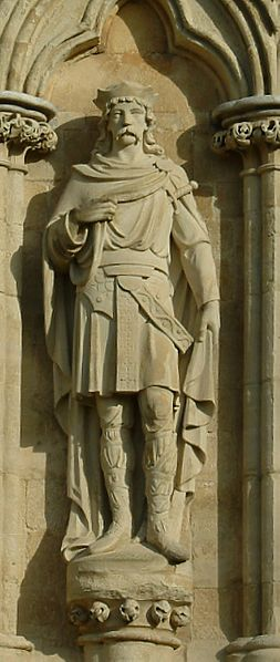 A statue of St. Edmund the Martyr on the West Front of Salisbury Cathedral, UK.