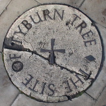 Stone marking the site of the Tyburn tree on the traffic island at the junction of Edgware Road, Marble Arch and Oxford Street