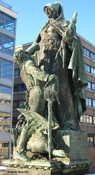 Statue of Saint Gertrude on Gertraudenbrücke in Berlin-Mitte by Rudolf Siemering (1896). St Gertrude's Bridge spans the Friedrichsgracht connecting the Spittelmarkt to Fisher Island. At its centre is this bronze statue of the Saint feeding a young boy a mug of beer or wine. Around the pedestal is a ring of rats and field mice.