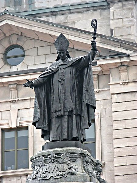 Statue of Bl. François de Montmorency-Laval, standing in front of the Bureau de Poste building in Old Quebec. Photo taken Andrea Schaffer.