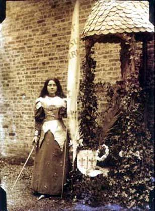 """St. Thérèse of Lisieux inside Carmel, dressed as St. Joan of Arc for a theater play she wrote titled, The Mission of Joan of Arc. St. Thérèse wrote: """"In my childhood, I dreamed of combating in the battlefield. When I began to learn the history of France, I was enchanted with the deeds of Joan of Arc; I felt in my heart a desire and courage to imitate them."""""""