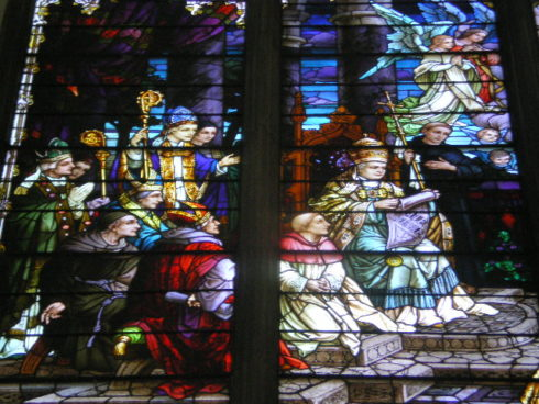 Close up of a stained glass window depicting the formal proclamation by Pius IX of the doctrine of the Immaculate Conception in 1854.