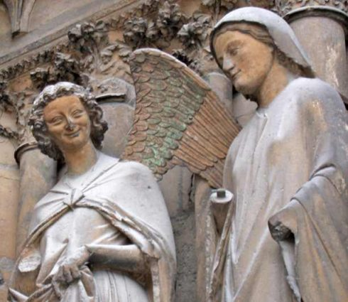 Our Lady and St. Gabriel on the central doorway at Reims Cathedral.