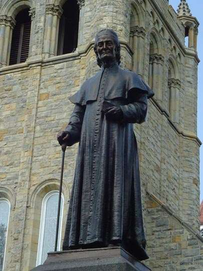 Statue of Fr. Demetrius Augustine Gallitzin in front of St. Michael's Chapel.
