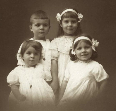 Left front is Marie-Antoinette and next to her is Magdeleine. Back is Jacques and Anne, who is eight years old.