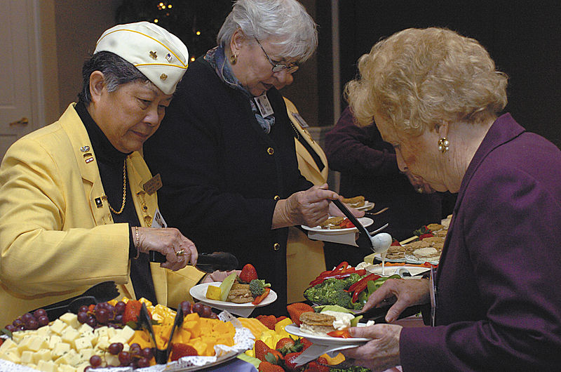 Members of the Gold Star Wives, enjoying a buffet of fruit, finger sandwiches, cheese and vegetables Friday at the Military Widows and Widowers High Tea event.
