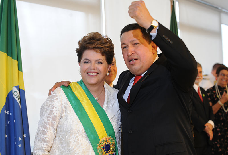 Former Brazilian President Dilma Vana Rousseff, who was impeached in August 2106 and removed from office. Pictured here with one of her many leftist supporters, Hugo Chavez, President of Venezuela. Photo by Agência Brasil.