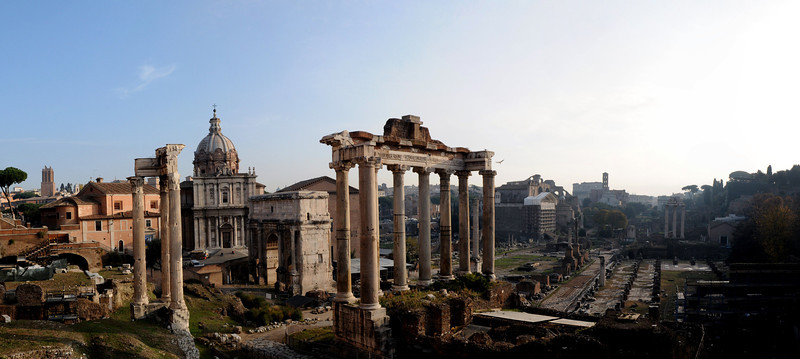The ruins of the Temple of Saturn with the Church of Saints Luca and Martina and the Mamertine Prison behind it.