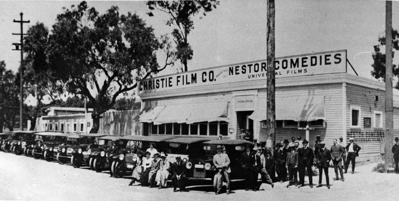 1913-Nestor Studios. The first motion picture studio in Hollywood was built by David Horseley for Christie Film Co. Automobiles are lined up at Sunset Blvd.