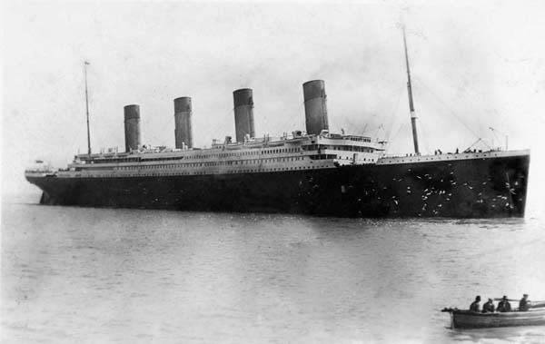 "One of Fr. Browne's last photographs of the Titanic April 11, 1912. A flock of gulls are flying around the Titanic's"" bow."